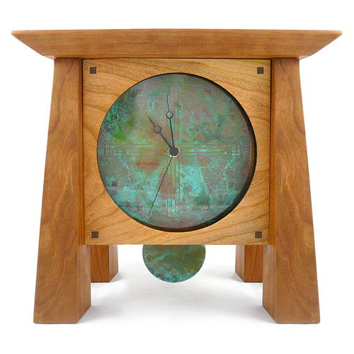 Prairie Mantel Clock with Copper Face and Pendulum. Classic craftsmanship with a timeless style! The Prairie Mantel Clock consists of natural kiln-dried cherry wood native to the Appalachian mountains, framing a clock-face of hand-tooled patina copper behind glass. The handsome merger of materials is further accented with the addition of a copper pendulum with the same rich green patina. A hand-rubbed finish of beeswax and mineral oil protects and optimizes the natural look of the cherry.