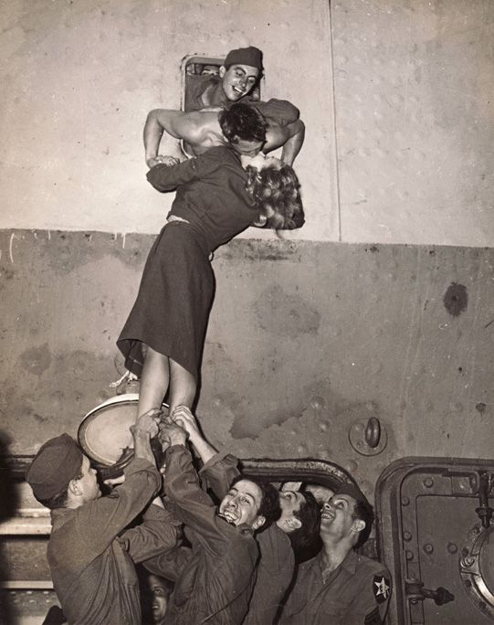 Marlene Dietrich Kissing a GI Returning from WWII, New York by  Unknown Artist