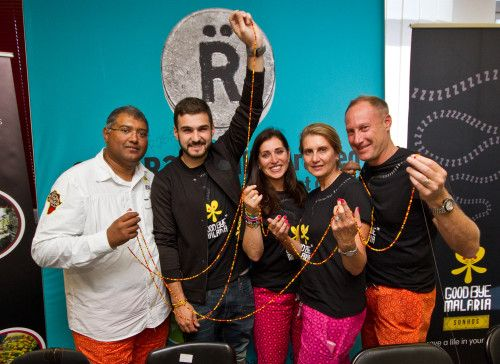 Sherwin Charles (Goodbye Malaria co-founder & CEO) J'Something (MiCasa Brand Ambassador), Lauren Gillis (Relate co-founder), Kim Lazarus (Goodbye Malaria co-founder) and Neil Robinson (Relate CEO) hold up their final threads from the Beading for Malaria Challenge 2015