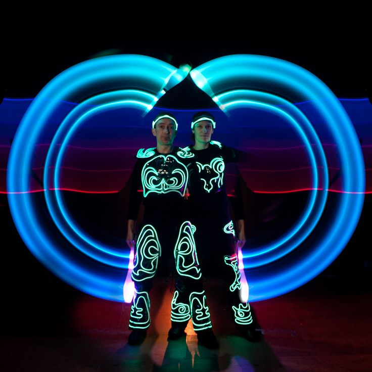 Glow are an LED duo who perform amazing glow shows. If you require a dazzling display in a darkened area and are unsure as to the suitability of a fire show to your event this option can't be beaten. Glow work together to create highly skilled juggling routines, which involve balls, clubs, poi, staff, hula hoops and other illuminated objects.