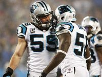 The Carolina Panthers' defense, led by Luke Kuechly and Thomas Davis, held the Arizona Cardinals to 78 yards Saturday, the fewest in NFL history, in a 27-16 wild-card win.