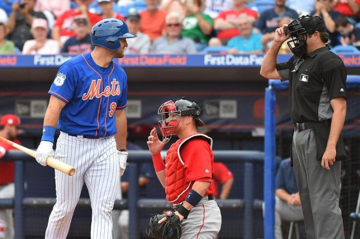 Tim Tebow has a little chat with the homeplate umpire as he's called out looking.