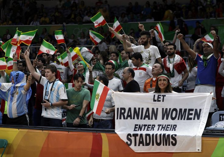 Security personnel at the Olympics threatened to eject an Iranian volleyball fan…