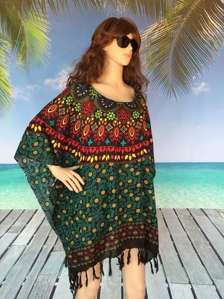 Plus size summer tunic top | Vibrant colours combined through a gorgeous array of abstract flowers in the stunning print design