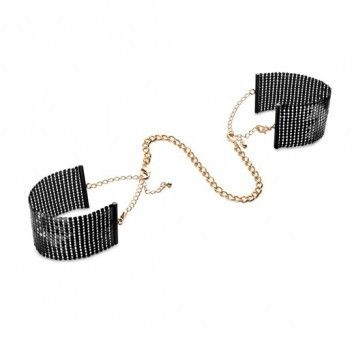 Desir Metallique - Black Metallic Mesh Handcuffs Reference:  BIJ0134 Condition:  New product  Satisfy your desire to conquer a heart of gold...  An easy-to-wear bracelets for any occasion; privately, they become suggestive handcuffs for soft bondage games.  Its cold and metallic touch turns everything into pleasure!  Content:  metallic mesh handcuffs.