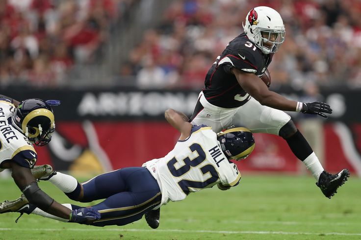 GLENDALE, AZ - OCTOBER 02: Running back David Johnson #31 of the Arizona Cardinals carries the football against cornerback Troy Hill #32 of the Los Angeles Rams in the first half of the NFL game at the University of Phoenix Stadium on October 2, 2016 in Glendale, Arizona.  (4042×2694)