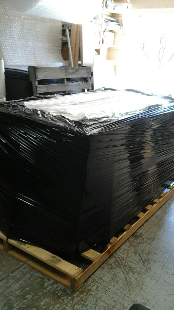 Sleep number  bed  had been  packed  on pallets  and ready  for  freight  truck  to  pick  up.