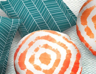 Festival Pillows in Orange with Teal  Cream Patterned Pillows