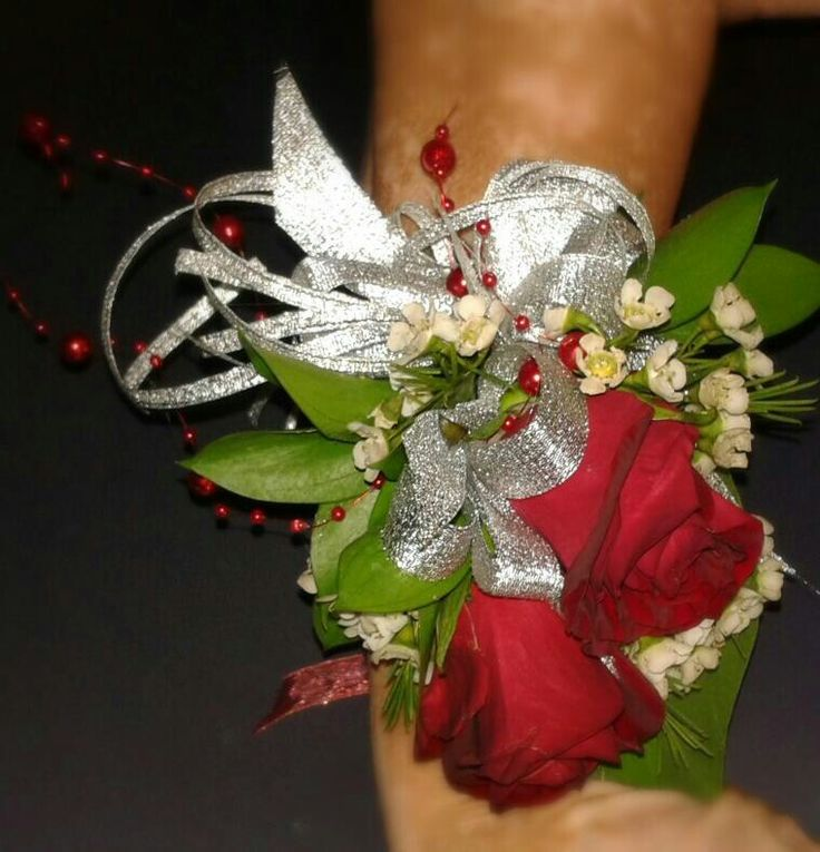 Red roses arm corsage with silver ribbon.