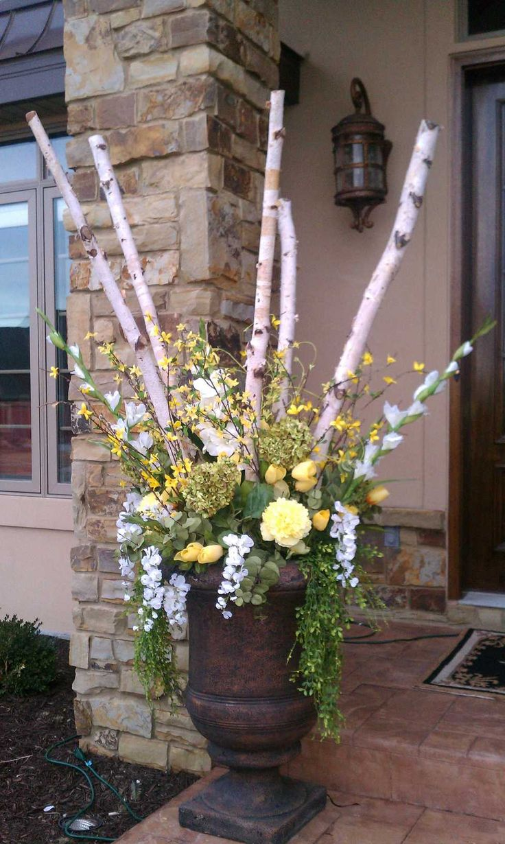 Spring urn arrangement with birch poles spring for Outdoor decorating with potted plants