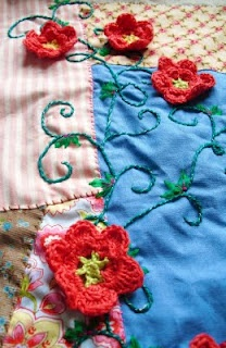crochet flowers on quilting blanket