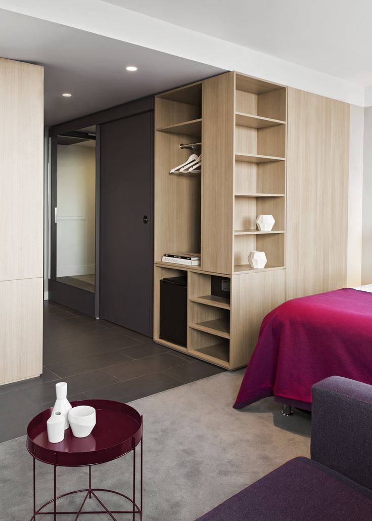 russia 2014 - international chain - river fontanka - skyscraper - hotel room - bedroom - built in furniture - wood - wardrobe - minimalism - smart concept - zimmer - einbaumöbel - holz - grau - rot - teppich - kleiderschrank - tisch - design