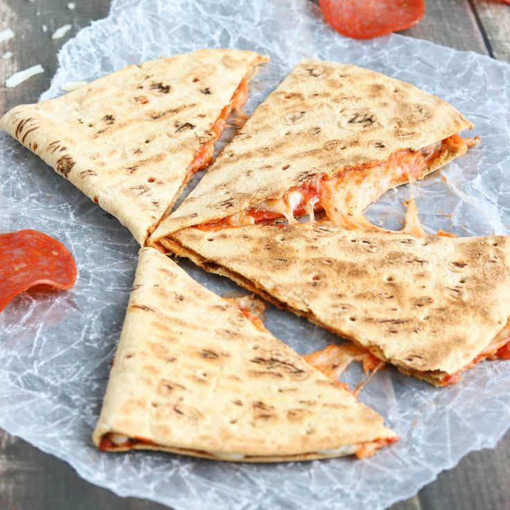 This easy Pepperoni Pizza Quesadilla recipe takes just minutes! With fiber-rich whole grains and lots of protein, it's perfect as a quick meal or a hearty power snack! | www.TwoHealthyKitchens.com