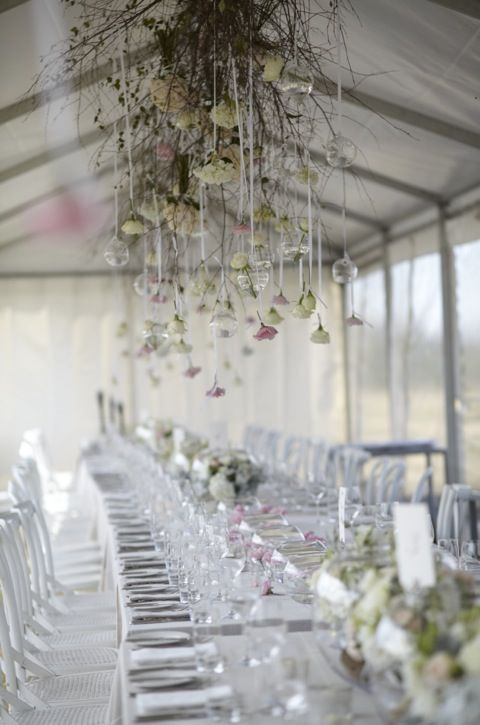 Hanging floral arrangement inside our celebrity weddings marquee reception.