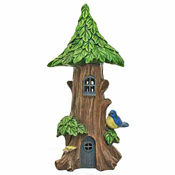 A Solar Powered Tree House with Little Bluebird. Has an interior solar light which lights automatically at dusk. The solar roof panel charges during the day to illuminate the LED light inside the house. Comes with rechargeable batteries and on/off switch.  Made from resin and hand painted.   ✿ Size: 7.5 x 15 cm high ✿ Suitable for outdoor use ✿ Gift Boxed  This item is not intended as a toy and due to the small parts used it is not recommended for very young children.