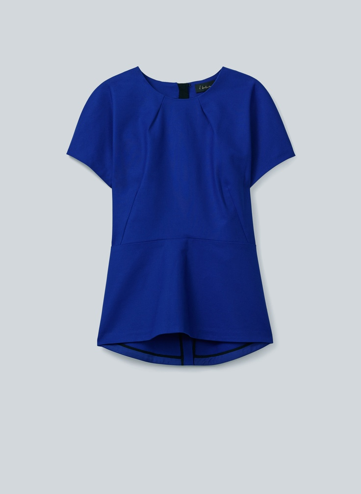T.Babaton Cody Blouse—the polished peplum top your wardrobe is craving.