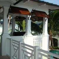 outside kitchen space; British West Indies Spanish Cedar Stained Bahama Shutters, 0065