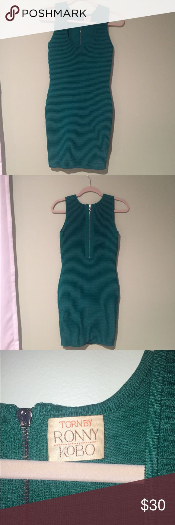 Torn by Ronny Kobo Emerald Green Bodycon Dress Beautiful emerald green bodycon dress with thick ribbed elastic fabric. Super stretchy and sturdy. Flattering to all bodies. Zip up back. Tag doesn't say, but about a size 2. Brand is Torn by Ronny Kobo. In amazing condition: Torn by Ronny Kobo Dresses Midi