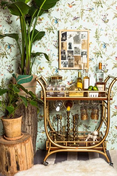 A little old school, a little retro - brass bar cart, candlesticks, gold etched glasses, Humming Birds wallpaper by Cole & Son