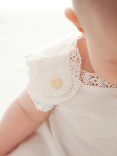 love the little detail of this dress. So simple and elegant for a little one.
