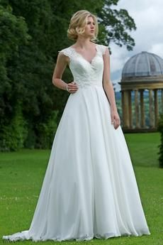Delicate chiffon and lace bridal gown with v-neckline and intricate beading