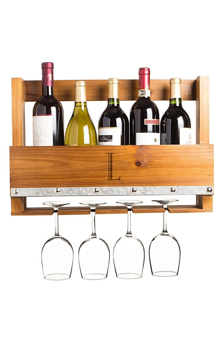 An engraved initial adds a custom touch to this rustic wooden wine rack that displays up to five bottles of the favorite vintages—while also hanging four wine glasses upside-down (and dust-free!) from the bottom ledge.