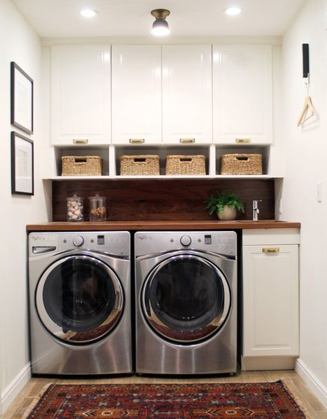 On Monday we unveiled our new laundry room makeover… did you see it? We're totally in love with the new space, especially the shelves and shiplap that we built. Well today we're sharing 20 amazing laundry room makeovers that we've found along the way for inspiration. Come take a look… Navy Modern Laundry Room by Bre Purposed …