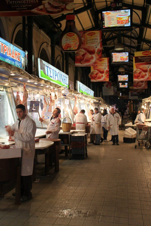 Butchers getting readyfor the day at the Athens Public Market....with my jet lag we were upat 4:30am watching them getready forthe day