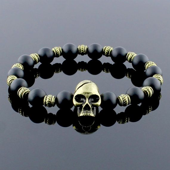 Bracelet Onyx de mort, Bracelet homme, Bracelet, Bracelet Onyx mat, Bracelet de pierres précieuses, bijoux pour homme, cadeau pour lui, cadeau ami, cadeau en perles  Détails : → Le bracelet de perles est de parfaits cadeaux. Bracelet tête de mort à la main → avec Perle en Bronze tête de mort → 8mm perles en Onyx mat Perle en Bronze tête de mort → → Les conceptions uniques et innovatrices sont fabriqués à la main et réalisées avec soin. → C'est un cadeau parfait pour vos proches!  ●●●●● s'il…