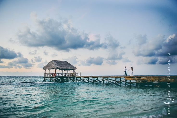 Wedding Photography - Groom and Bride dancing on a pier