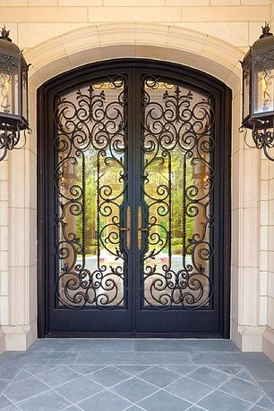 Art Deco Front Door with exterior terracotta tile floors, French doors, exterior tile floors