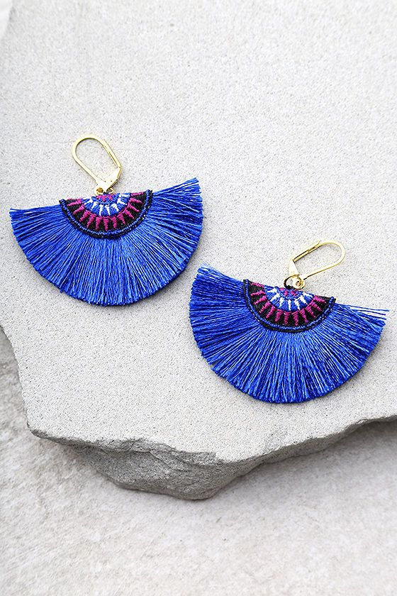 "Create your own unique look with the Shashi Sophie Blue Earrings! A blue tassel fan with blue, purple, black, and white embroidery. Earrings measure 2"" long."