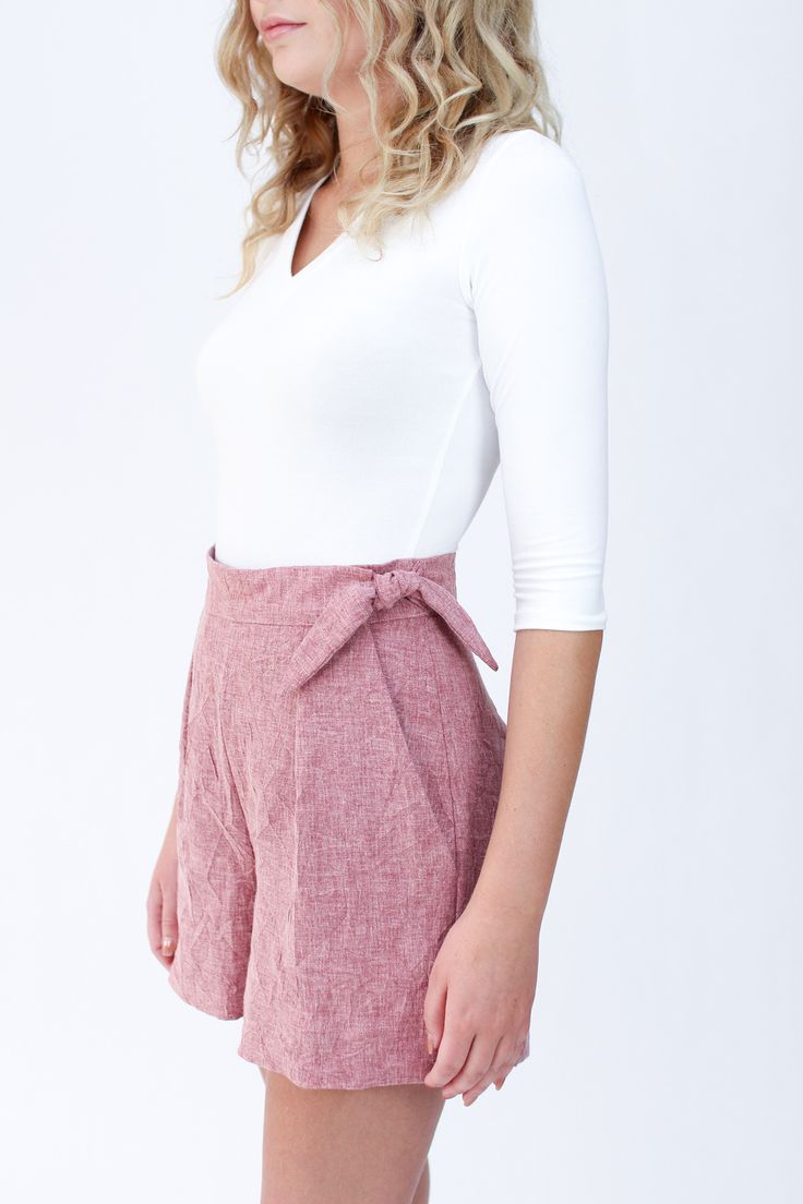 Flint pants and shorts sewing pattern // Wide leg cropped pants or shorts with unique crossover closure at the side seam. Pattern sits on the natural waist and features hidden closure at the left pocket , release tucks at the front, darts at the back, slash pockets, two waistband options and two lengths.