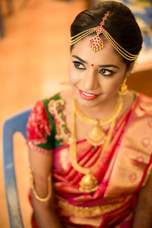 South Indian bride. Gold Indian bridal jewelry.Temple jewelry. Jhumkis.Green and red silk kanchipuram sari.Braid with fresh jasmine flowers. Tamil bride. Telugu bride. Kannada bride. Hindu bride. Malayalee bride.Kerala bride.South Indian wedding.