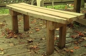 Deck Idea: 2x4 Bench (from old deck).  The bench painted to coordinate with the screen door would help anchor the look.