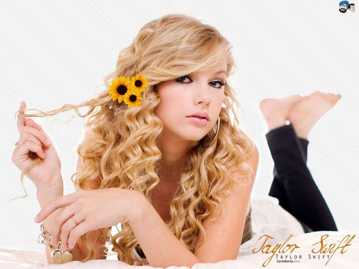 Image from http://media1.santabanta.com/full1/Global%20Celebrities(F)/Taylor%20Swift/taylor-swift-20a.jpg.