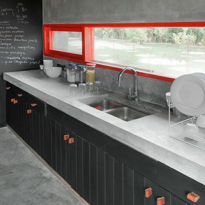Kitchen with red window frame: Interiors. Also loving the massive black wall as blackboard