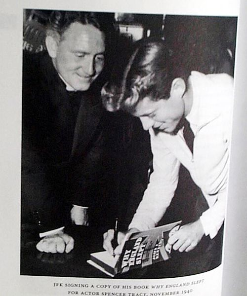 "John F. Kennedy signing a copy of his book ""Why England Slept"" for actor Spencer Tracy, November 1940."