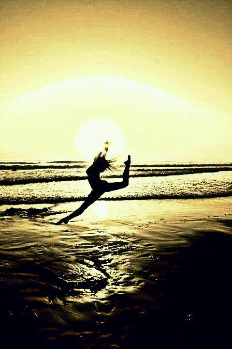 She can fly!  I had a similar photo taken of me when I was younger in, ♡Gymnastics♡!