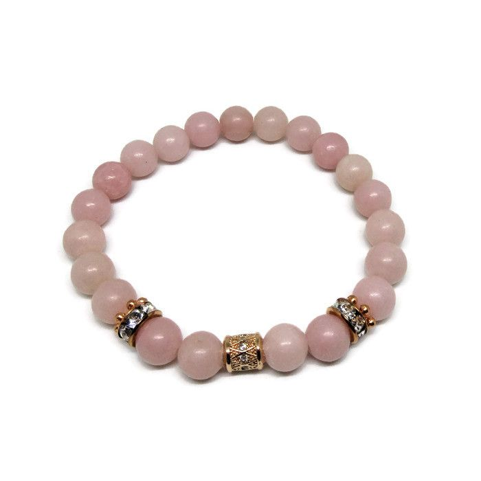 Natural Peruvian Pink Opal 8 mm bead bracelet with cubic zirconia rose gold column bead and rose gold rhinestones. This bracelet will bring you love and happiness. Get yours today!