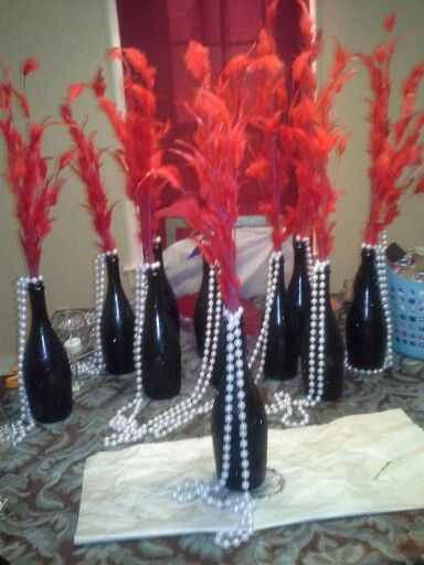 Wine bottles for Roaring 20's Party - recycle old things and dress them up with feathers,sparkles ...