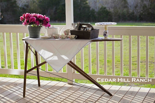 Wooden Ironing Board Turned Sideboard. I have one. I should totally do this on the front porch!!
