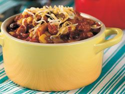 Texas Turkey Chili made a bit healthier with lean ground turkey. Add the tomatoes, beans, and corn and seasonings. Into a crock pot and forget it for 6 hrs. on low. Grab and bowl and the condiments of your choice and dinner is ready!