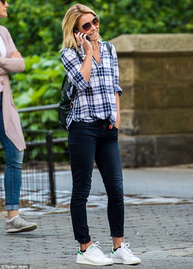 Happy: Kelly Ripa, 45, was in good spirits as she chatted on her phone while in Central Park in NYC on Thursday afternoon
