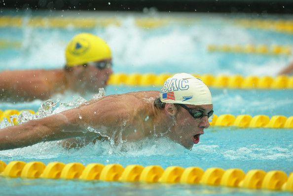 Michael Phelps Photos Photos - Michael Phelps competes in the men's100m butterfly during the Janet Evans Invitational on July 20, 2002 at the McDonald's Swim Stadium in Los Angeles, California. - Janet Evans Invitational