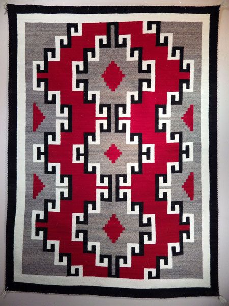 This Navajo weaver knew how to make that red sing! She double dyed the hand spun native wool twice, and it hasn't faded at all in 75 years.