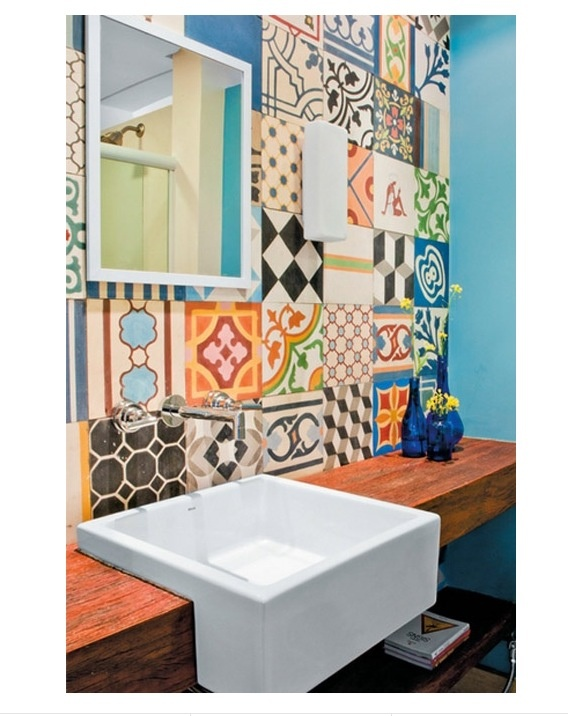 "ECLECTIC, SIMPLE: Functional pieces (sink, mirror) are very simple and unadorned, but they are set against a background with a patchwork of different patterns and colors. I like to outwardly appear dressed down, casual, and functional, but have a much more active ""inner world"""