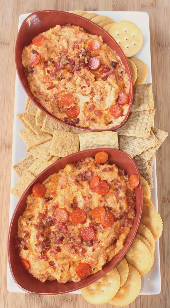 This Slow Cooker Meat Lovers Pizza Dip is the perfect dip to make for tailgating!! A huge hit with kids and adults, plus it's easy to make as well!
