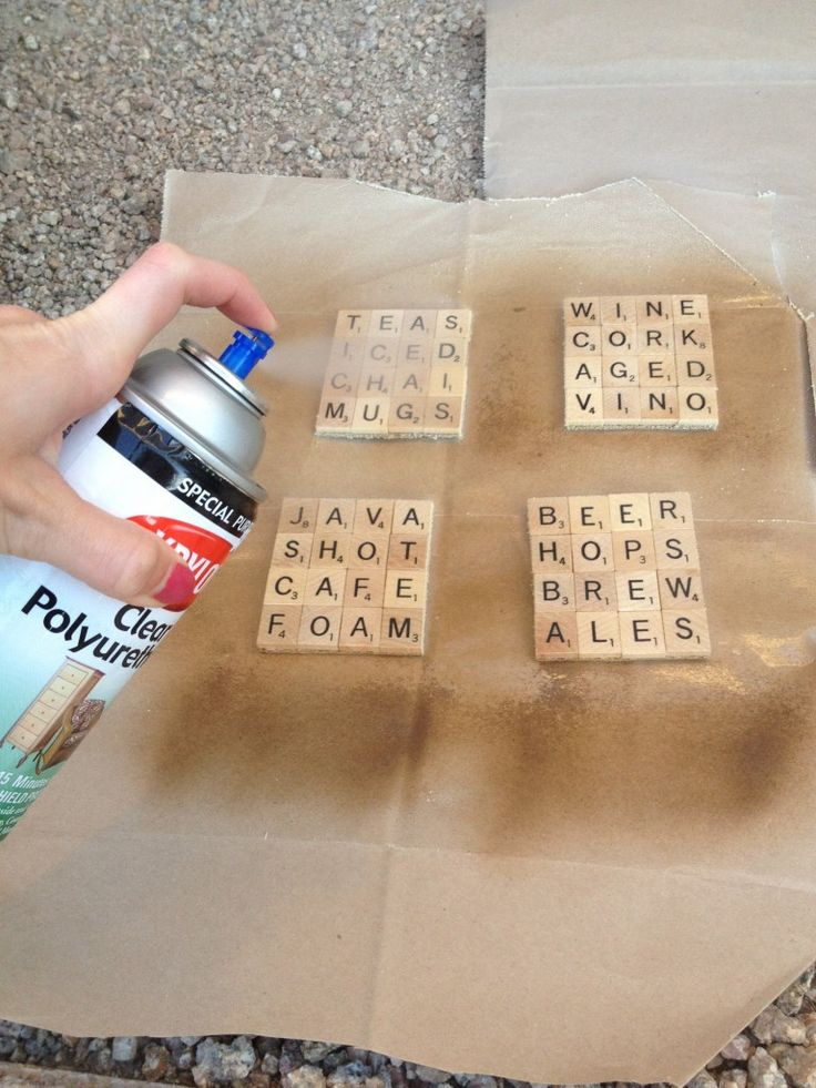 Scrabble Coasters You'll need:  A package of gently used, square edged Scrabble tiles* E-6000 glue 1 thin cork board or pre-cut cork coasters Sharp scissors or an X-acto knife Clear Polyurethane spray *I purchased two packs of 100-letters from Amazon for more variety of letters (ran out of C's and P's with the first package).