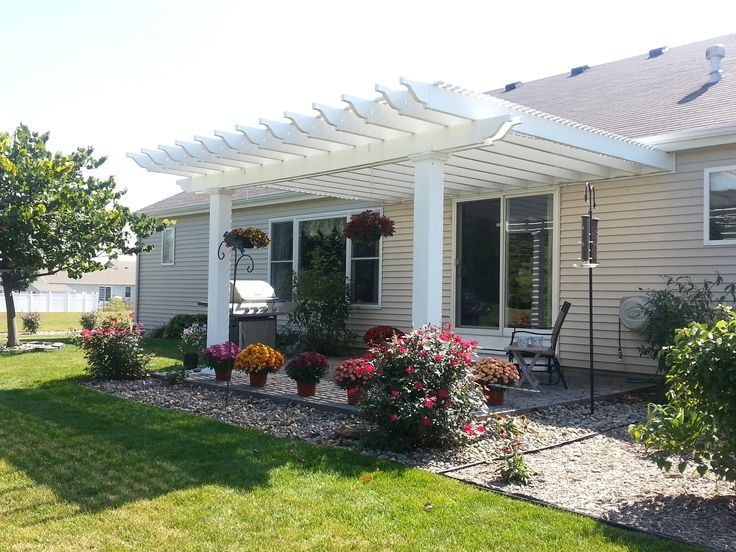 A pergola can turn a small and simple patio into an elegant outdoor living space!